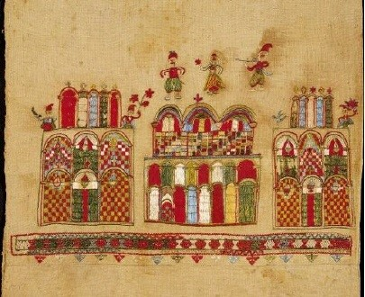 Bridal cushion from Skyros island with a scene containing three monumental structures on which human figures are depicted. The structure in the middle is surmounted with a miniature scene of a wedding, the bridal couple and a musician. 18th c. 0.44x0.43 m. (ΓΕ 6390) image and text copyright Benaki Museum