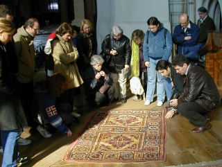 Examining a Ghirlandaio type rug in the Black Church, Brasov 2002