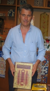 Stefano Ionescu with his bench-mark publication on Anatolian rugs in Transylvani