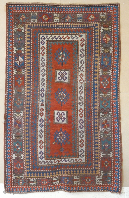 "Kazak rug, 2.40m x 1.50m, 7'10"" x 4'11"", 19th century. Very well-balanced design with some early features. Some minor damage, old repairs and corrosion/ replaced browns."