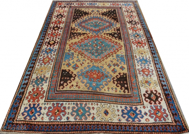 "Rare Borjalou Kazak rug, 196cm x 135cm (6'5"" x 4'4"", circa 1875. An exceptional example. Typical use of repeating hooked lozenges, but filled with very unusual scattered kites! Lovely palette with a  ..."