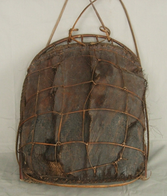"India, Himalayas: Fine and rare old rattan ""tali"" basket with a contracted mouth from the Idu Mishmi ethnic group of Arunachal Pradesh, India. In India they are primarily animist but in China  ..."