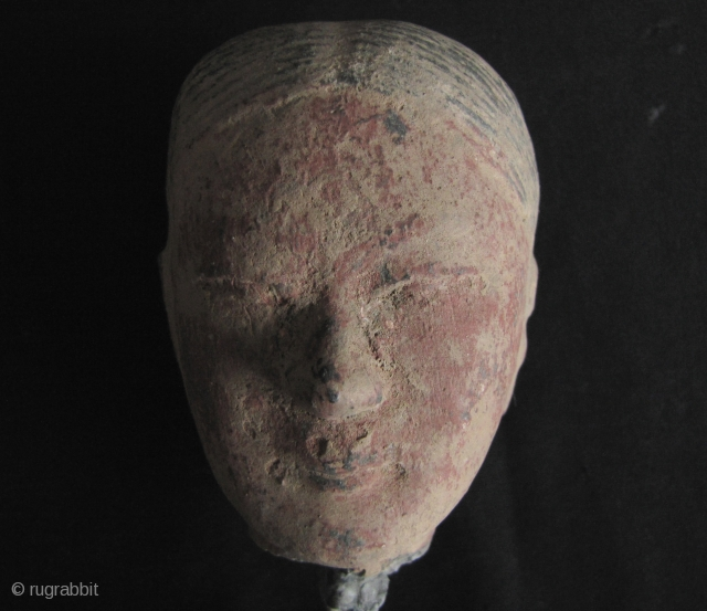 Han Dynasty pottery head of a female court attendant.  A lovely face with sensitive features, original red pigments on face, this image embodies the most classic style of Han sculpture. There  ...