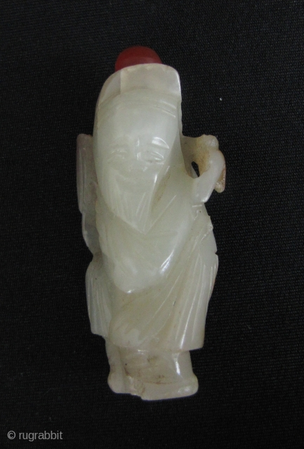 Jade Immortal: Charming Qing Dynasty nephrite jade carving of an immortal with russet highlights, this was made into a snuff bottle as an afterthought and is not original. May be worn as  ...