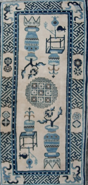Good early 20th century (circa 1920) rug woven in Inner Mongolia with classic Bogu- precious objects pattern. Aside from about 1.5cm missing from the head ends this piece is in excellent condition-  ...
