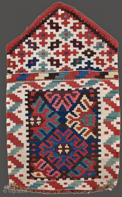 Very graphic and attractive Shahsavan Kilim Mafrash head panel with triangular flap. Late 19th/early 20th c. 76x95 cm. Nice colours and perfect condition.