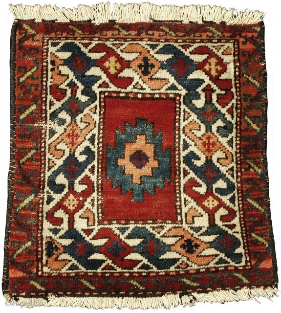 Pile khorjin face, Shahsavan Confederacy. Northwest Persia, Circa 1880, 48 x 45 cm (19 x 17.5 in.)   Knot count:13 H x 15 V = 195 kpsi. Colours:red, peach, blue, yellow, blue-green, dark brown,  ...