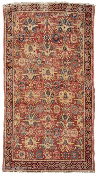 """Rug with Mughal floral pattern Kashgar oasis Eastern Turkestan 18th century 208 x 118 cm (6'11"""" x 3'10"""")  Alg 2033 asymmetrically knotted wool pile open to the left on a cotton foundation An extremely rare and early east  ..."""