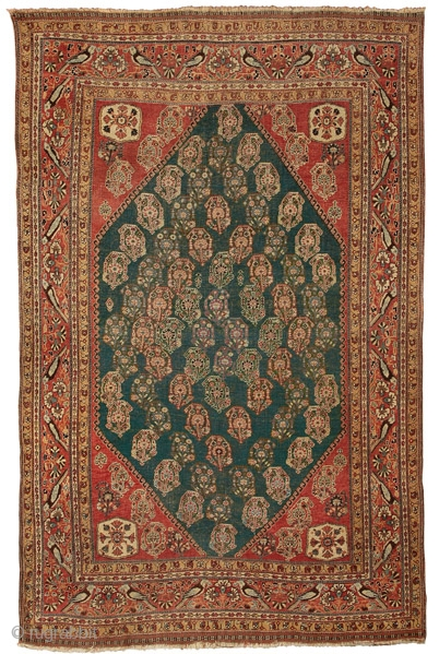 """Green ground Qashqa'i rug Qashquli tribe Southern Persia circa 1880 222 x 138 cm (7'3"""" x 4'6"""")  L 123 asymmetrically knotted wool pile open to the left on a wool foundation  The carpets of the Qashqa'i confederacy often  ..."""