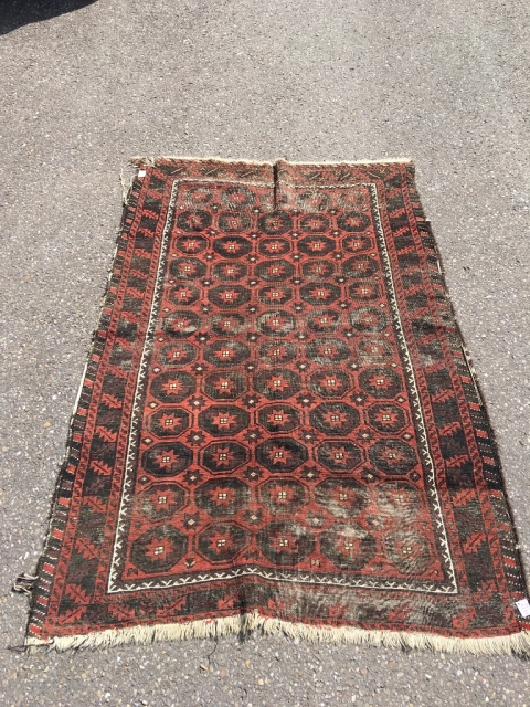 Baluch main rug with unusual field design. Deep corrosion, wear. 6,46 x 4,36 ft (197 x 133 cm). As found, not cleaned. Rugrabbit link not working? Email me directly at alexanderbakker@flairforflavor.com.