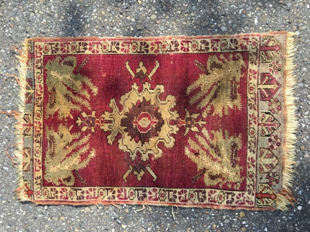 First half 19th century Kirsehir yastik. Oblong orientation of the design, as a cushion front, not a wall hanging. Refined and irregular drawing, still reminiscent of the great Ushak era, before standardization  ...