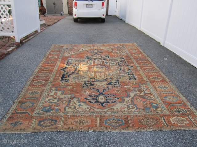 "antique persian heriz serapi measuring 8' 3"" x 11' 6"" no pets no smoke no dry rot in very poor condition with lots of old repair cuts tear  as found being  ..."