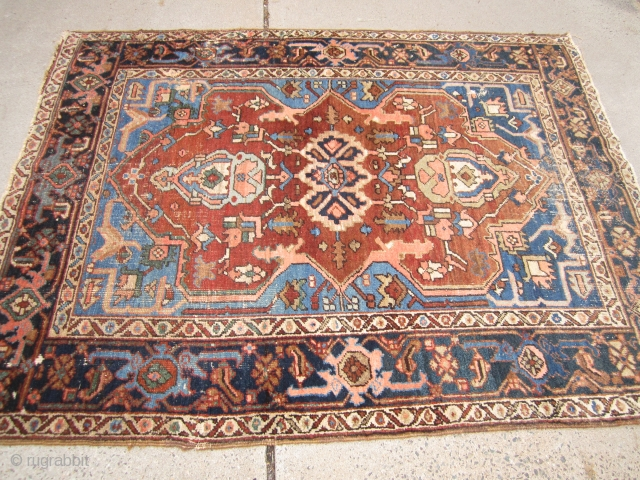 "antique serapi heriz rug measuring 4' 11"" x 6' 2"" condition as shown one hole area of wear and scattered moth issue generally a good pile has been cleaned ends need work  ..."