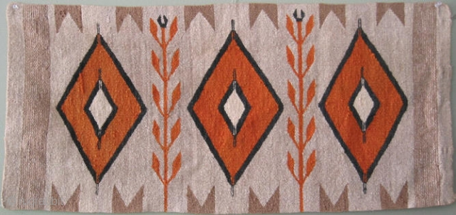 Navajo horse blanket, SW United States, 1st Qtr 20thC, corn stalks and three orange diamonds, outlined in black with a periwinkle tint, and a nice faded golden tan that once had a  ...