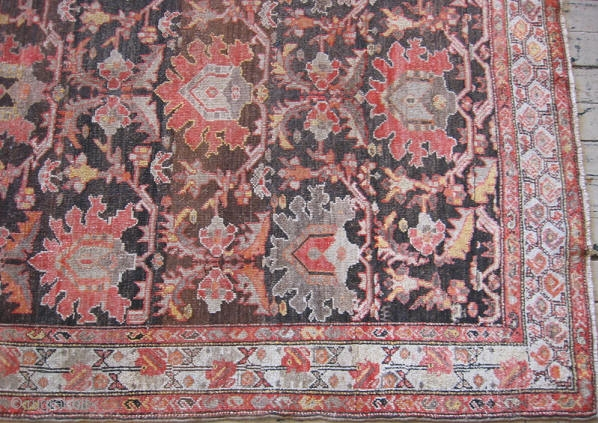 Persian Malayer rug, hand knotted wool, Iran, ca.1900, palmetts in Mandarin orange, Imari red, melon, taupe, charcoal, and camel on a chocolate field, ivory border, low even pile with some professional restoration,  ...