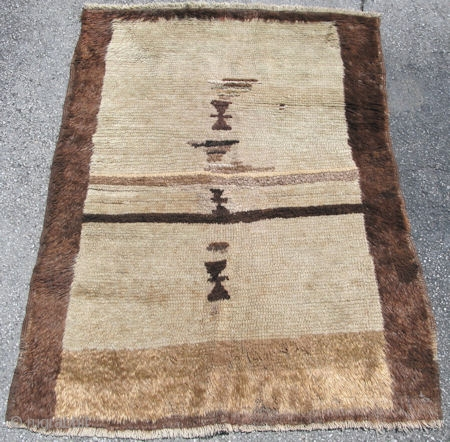 Shaggy primitive Tulu rug, hand knotted with glossy wool or mohair, condition is good with small amounts of reweave, Turkey, 1st half 20thC, beige, with natural tan and brown, size 3 ft.  ...
