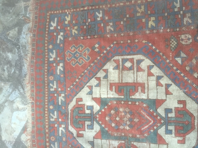 Pleasing kazak rug. Late 19th century with good abrash and asymetrical icons. Has a charm. Few small holes, small stain, tear on one end but pretty much untouched. Needs a good clean.  ...