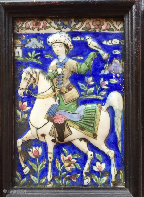 super antique Persian Qajar tile with mounted falconer prince mid 19C size 22 x 14 cm + frame. In antique wooden frame some small blemishes to glaze (see detail) quite possibly from  ...