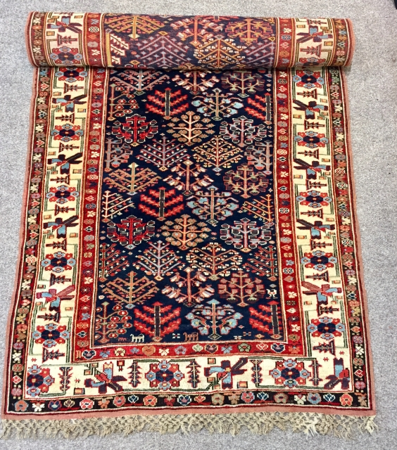 Lovely north west Persian shrub design long rug. 
