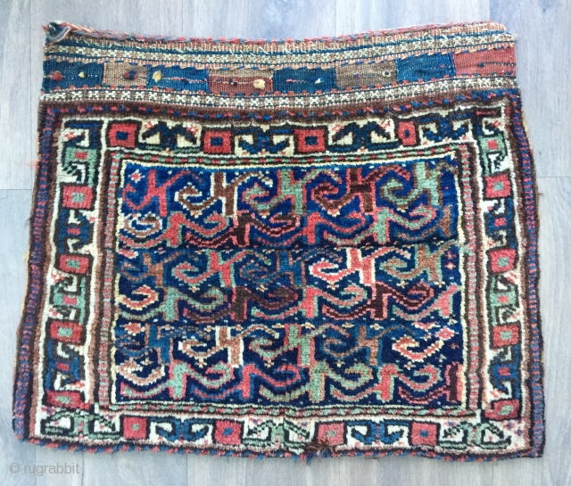 Unusual antique bagface probably made by Kurds of the veramin area  All natural dyes handspun undyed Ivory warps with various shades of red and brown (dyed and undyed) handspun wool wefts.  ...