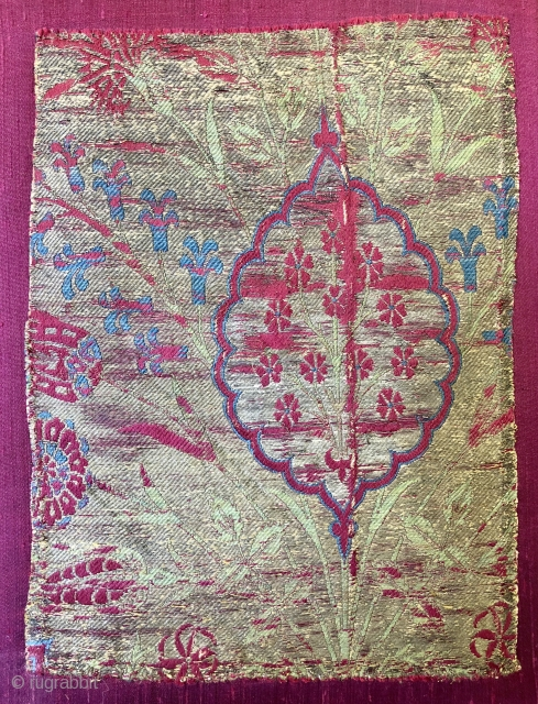 A beautiful Ottoman silk and gold wrapped thread Lampas fragment (Kehma) ca 1570-80 probably Istanbul. size 24 x 17 cm stretcher Mounted on raw silk backing.   A similar example on  ...