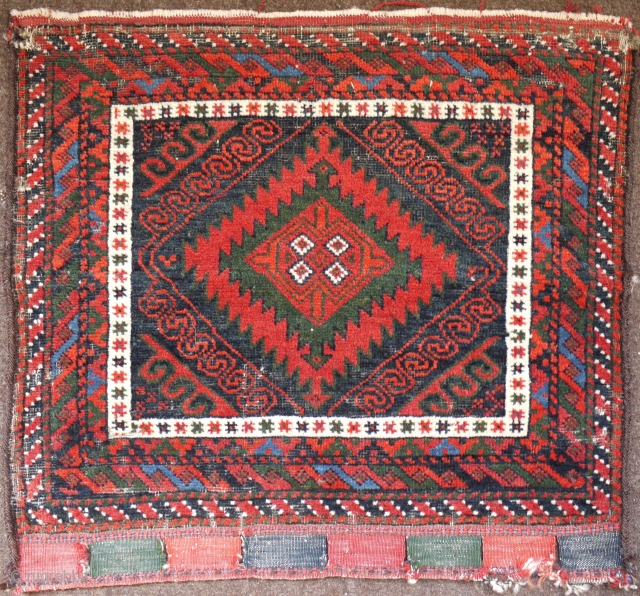 fine  antique Mashwani Baluch bagface ca 1880 size 53 x 49 cm.  All wool and natural dyes including a lovely green and light blue. Original lappets and goat hair selvedges.  ...