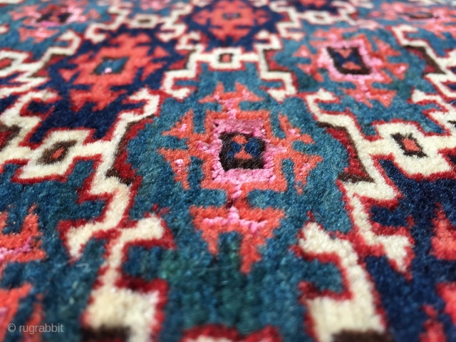 Turkmen aksu design with silk highlights.