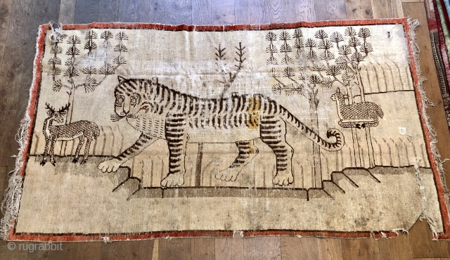 Lovely antique Khotan tiger late 19 c size 95 x 53 inches
