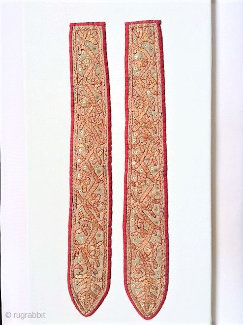 A pair of ceremonial piece from Indonesia. Left and right from sitting pillow.  Gold/Metall needlework, very fine in a very good condition.  size each piece: 57cm x 8cm