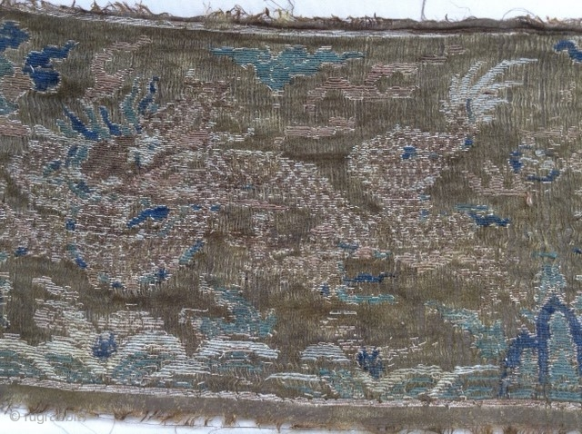 Very old silk textile from Tibet. Two Dragons, in the middle may be the holy mountain Kailash. It is extrem fine.