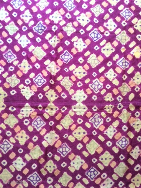 Ceremonial plangi from Bali, very fine silk fabric with beautiful coloures in red/violet and yellow /orange.