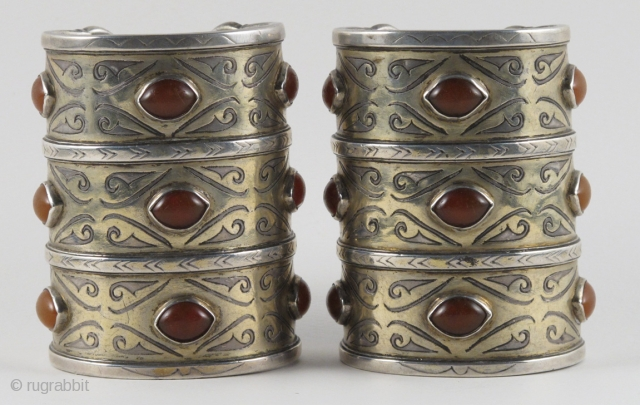 Exceptional pair of Antique Tekke Turkoman cuffs. These date from the late 19th to early 20th century. The traditional fire gilding and carnelian cabochons are in excellent shape; the fine silver is  ...