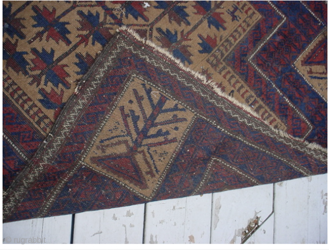 Very early Baluch prayer rug containing an unusual archaic design.