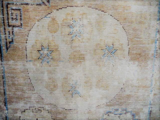 SOLD  Khotan  :beautiful early rug 18/19thc. faded logwood, complete, not rotten, pretty knackered