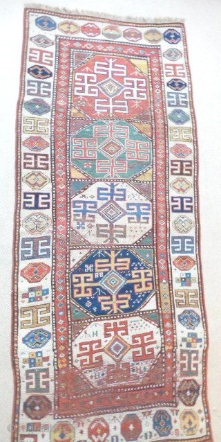 Gorgeous early Kazak long rug,first half 19thcent. lovely colours, old repairs,rebound sidecords,  8ft3in x 3ft4in SOLD