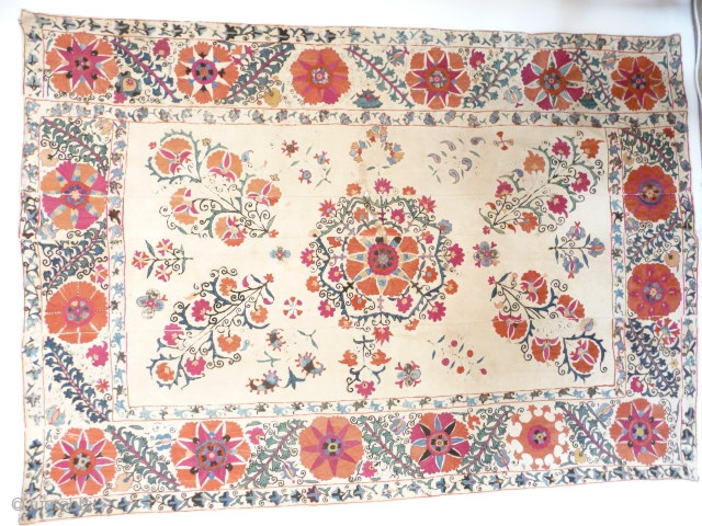 Lovely old suzani , 19th cent. good colours with a powerful border , unlined with some of the embroidery rubbed and repairable damaged area in the centre, cotton ground strong, not pristine  ...