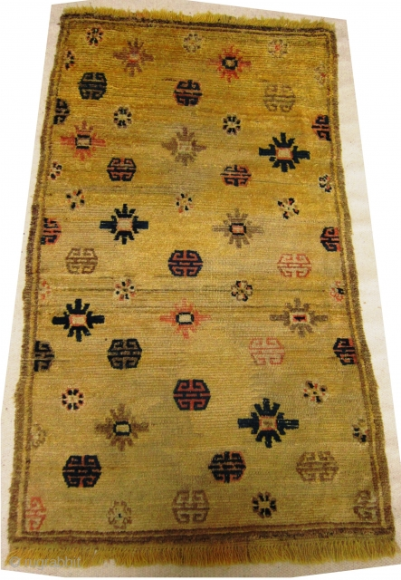 Mid 19th century Tibetan Prayer rug in Ningxia yellow, size 84cm x 141cm, Fringes on both ends are not original there are three small repairs in the field. Pile wear to centre.  ...