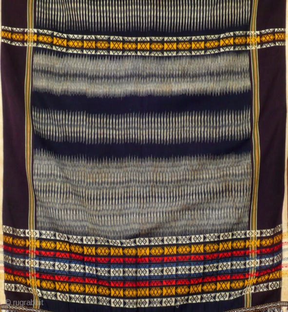 Shawl, ulos, Toba Batak/Sumatra/ Indonesia, before mid 20th century Handwoven cloth, extremely fine cotton, very refined ikat work, colourfull supplementary weft pattern stripes, thoroughly twined ends, nicely twisted fringes,This type of ulos is  ...