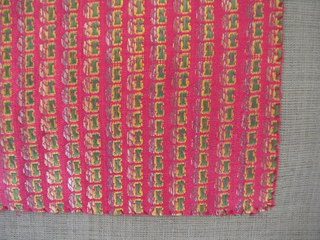 Antique piece of cloth, silk, brocade, Bengal, India, 19th century  Handwoven brocade, series of a particular small form,green, yellow and grey, supplementary warp threads on on red underground, traces of use,some small stains,  ...