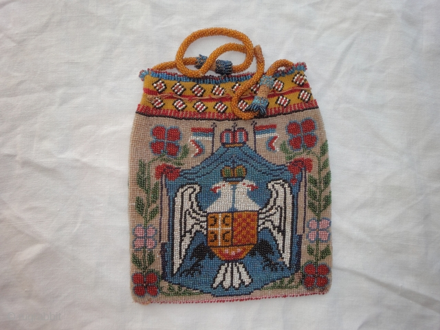 A good beadwork Serbian coat of arms bag. Very good condition. Both sides same. Cm 16 x 18. No repairs.