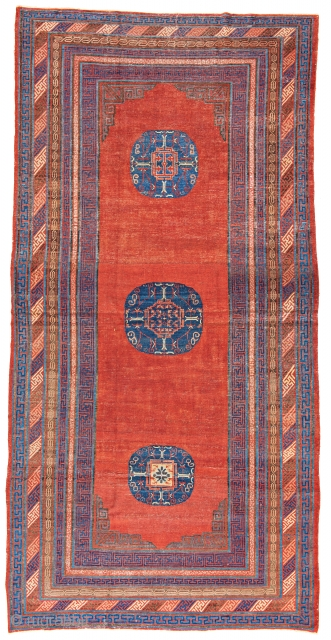 Lot 68, Khotan, 12 ft. 2 in. x 6 ft. 1 in., Eastern Turkestan, ca. 1800, Condition: good according to age, pile partly low, few small repairs and reweavings, Warp: cotton, weft:  ...