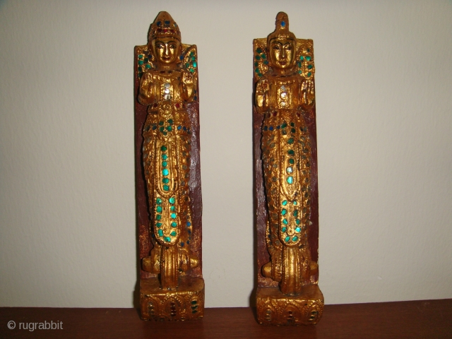 "Rare, Antique 19thCentury Burmese Male & Female Guardian Spirit (""Nat"") wooden satuettes. Lacquered, Gold-gilt with coloured glass inlay. Made as handles for a Prayer chamber door or cupboard for storing religious articles.  ..."