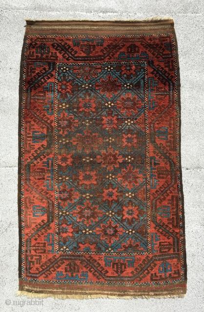 "Baluch rug . 4'9"" x 2'10""."