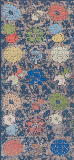 A Ming dynasty textile fragment with incredible color and a bevy of Chinese symbols dispersed throughout it's two layered design. The top design is done in silk brocade, while the underlying design  ...