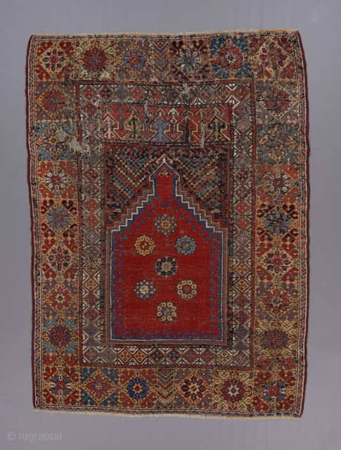 "18th century Mujur prayer rug . 5'7"" x 4'. Great color and classic design . Small repairs scattered throughout ."