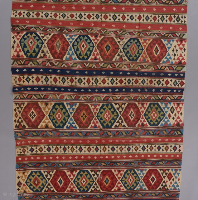 "Caucasian Kilim with a beautiful springtime color palette. An early one of it's type. 11' x 5'4""."