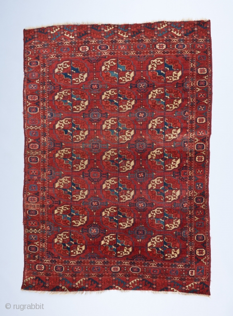 An early Tekke wedding? rug with great color and a fine weave. Beautiful spacing in the field design and a bevy of interesting devices in the border. Missing a bit on each  ...