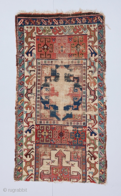 A Chan Karabagh fragment. Probably first half of the 19th century. Interesting cross design usually seen in Shahsavan bags. Beautifully articulated border of the type, with a two-bird head variant. Great color  ...