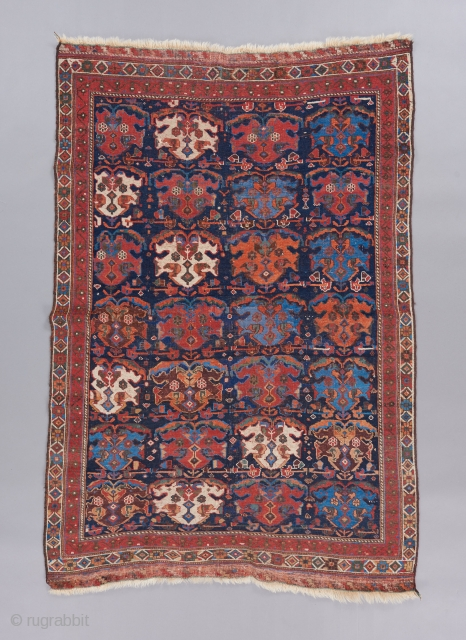 "Afshar rug with great color and a superb rendition of a classic design. Supple handle and fine weave. A small amount of old repair. 5'8"" x 3'8"". 
