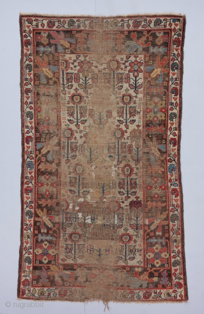"Circa 1800 Kurdish rug with a beat up but beautiful field of three different flower forms. Great scale in the drawing. 6'8"" x 3'10""."
